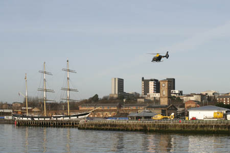 Helicopter lands at the City Heliport on the Clyde